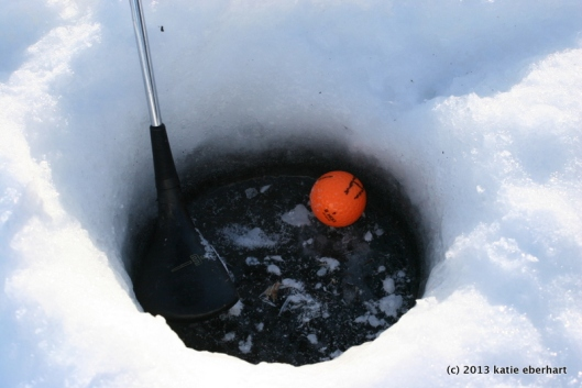 Ice golf. Hole-in-one? Or ultimate sand trap?